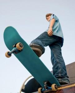 Teenage boy on skateboard