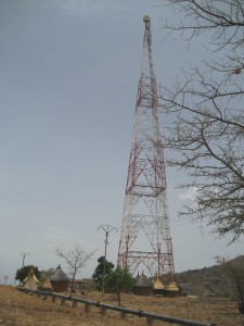 Cell tower & huts - Far North, Cameroon