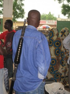 Dude with gun - Bus station, Maroua, Cameroon