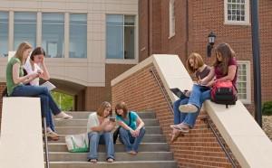 Teenagers on school steps